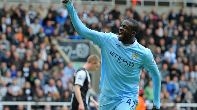 Manchester City midfielder Yaya Toure celebrates the two goals that could prove crucial in the EPL title race.