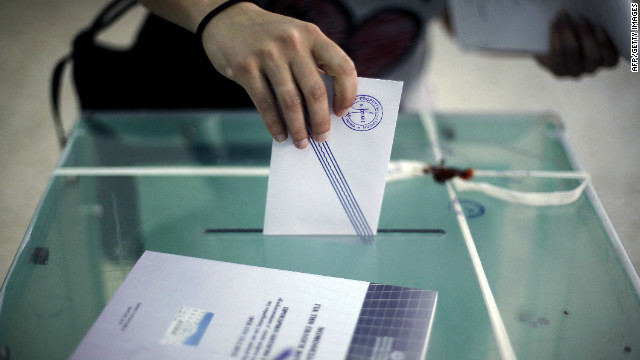 A woman casts her vote for Greece's general elections in Athens on May 6, 2012.