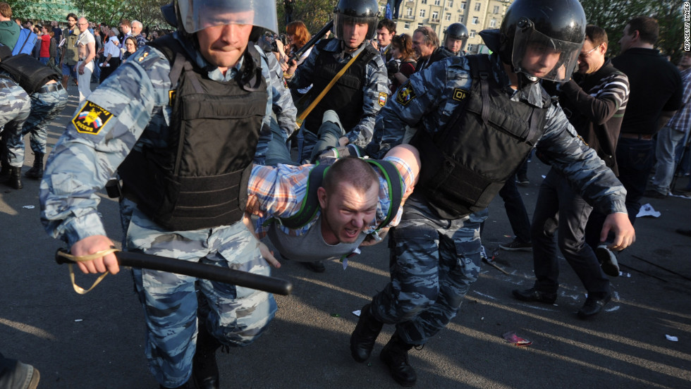 Russian police detain a protester during a rally in Moscow on Sunday, May 6, the eve of Vladimir Putin's return as president.