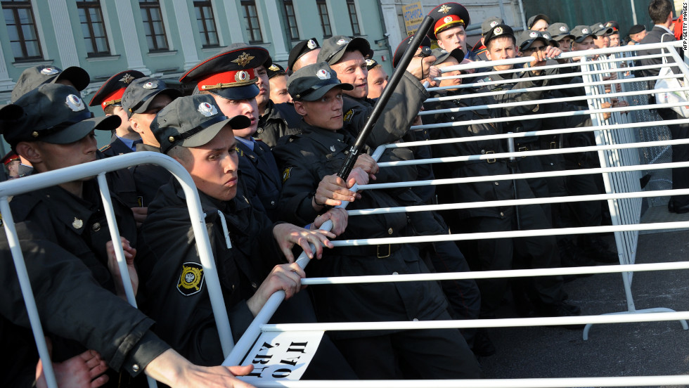 Russian police officers attempt to block off a street during the rally in Moscow.