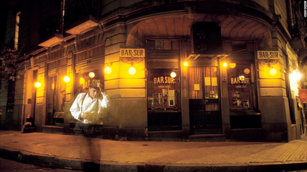 """A young tango dancer performs outside an old world café in the bohemian district of San Telmo, Buenos Aires. It's not uncommon stumble across many a """"tanguero"""" busking for change across the capital city."""