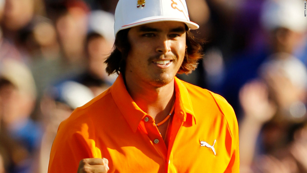 Rickie Fowler, one of golf's most colorful characters, celebrates his first PGA Tour title at Quail Hollow, where he won in a playoff against 2010 champion Rory McIlroy and D.A. Points.