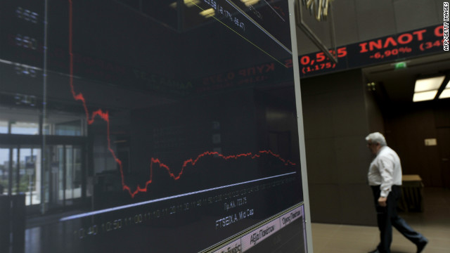 An employee walks by an index at Athens stock exchange on May 7.
