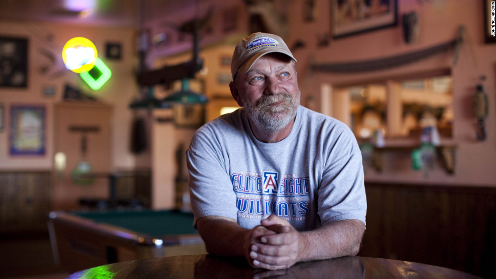 Schmidt is pictured inside his bar, Johnny Ringo's, in Tombstone. He won the recall election by 51 votes but says he will continue the city's lawsuit under the conservative Goldwater Institute.