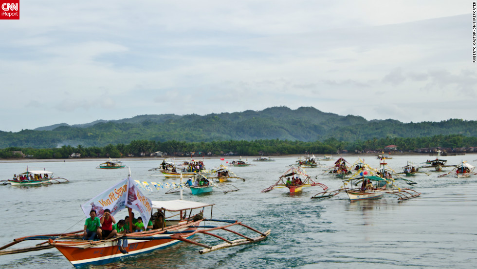 iReporter Roberto Castor returns to his hometown of Isabel almost every January for the Santo Nino (Little Jesus) fiesta, known locally as the Sinulog festival.  His photo depicts religious pilgrims in small boats following the main barge, which parades a status of Little Jesus in hopes for a prosperous year ahead.