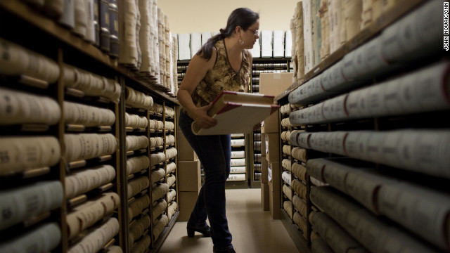 Tombstone archivist Nancy Sosa searches for documents at the Cochise County Recorder's Office.