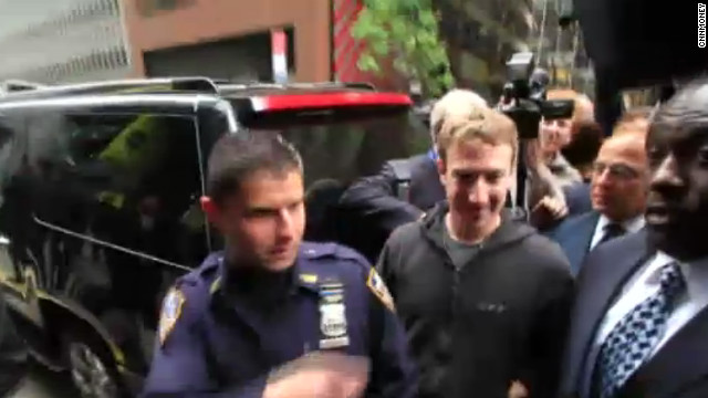 Facebook CEO Mark Zuckerberg arrives to meet with investors in New York on Monday while wearing his iconic hoodie.