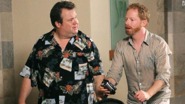 """Modern Family's"" Mitchell Pritchett (Jesse Tyler Ferguson) and Cameron Tucker (Eric Stonestreet) adopt a baby girl."