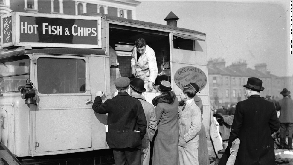 Customers circa 1935 queue at a van at Caledonian Market, London. Britons have been enjoying fish and chips for an estimated 150 years.