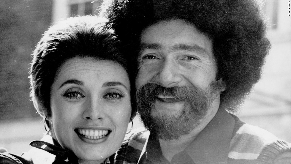 Vidal Sassoon, with his second wife Beverly, wearing a false beard, sideburns and wig, to mark the opening of his new barbers shop in 1972. He divorced three times and married his fourth wife in 1992.