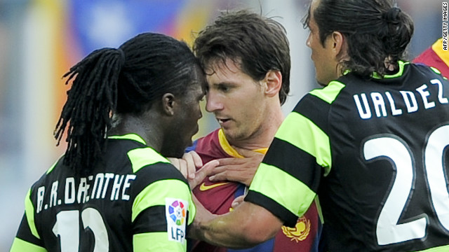 Royston Drenthe clashed with Lionel Messi while playing for Hercules against Barcelona in 2010.