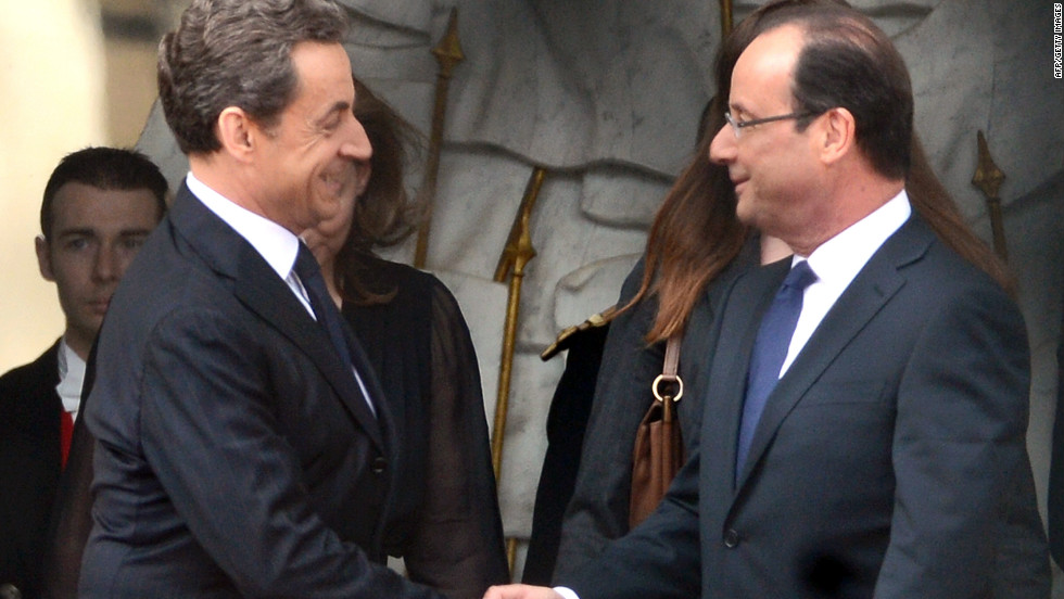 Outgoing President Nicolas Sarkozy, left, welcomes his successor at the Élysée Palace.