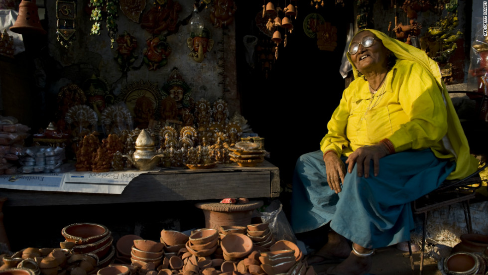 "An Indian woman sells earthenware oil pots or ""diyas"" at a roadside stall in the run up to last year's Diwali Festival. Diyas are in heavy demand during the festival as they are used to hold lit oil lamps and decorate the interior and exterior of homes."