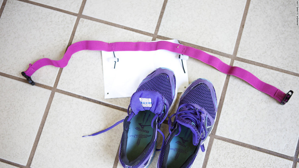 """The team learns about """"transition spaces,"""" where athletes place their biking or running gear in certain positions to make it easy to go from swimming to biking or biking to running. Here sneakers are lined up with a triathlete's race number."""