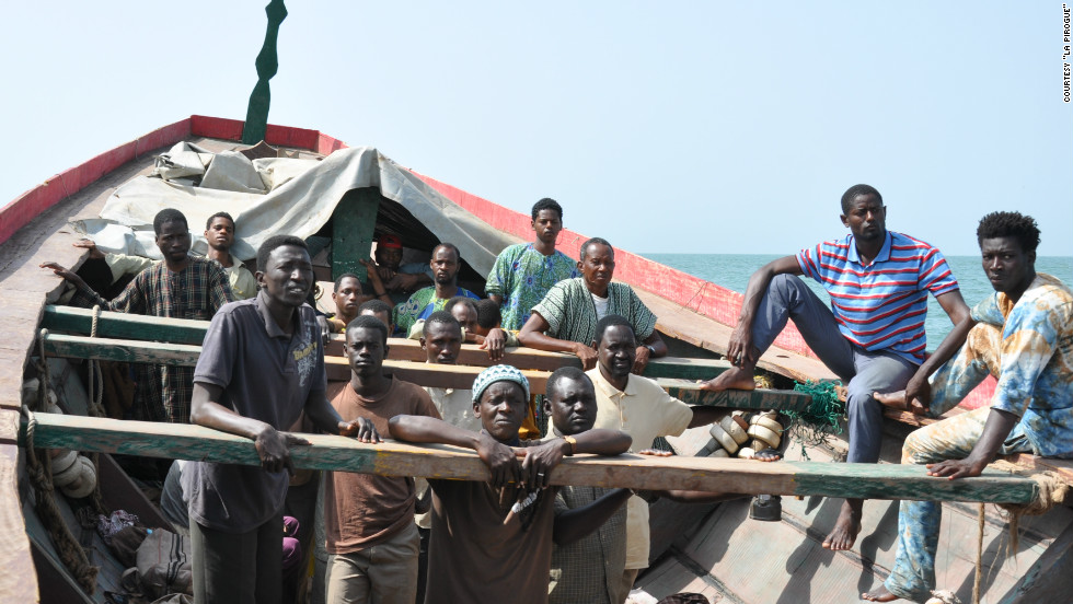The 30 men are crowded in the boat in intolerable conditions. Toure said filming had its hazardous moments, as some of the cast, like the characters they played, could not swim.