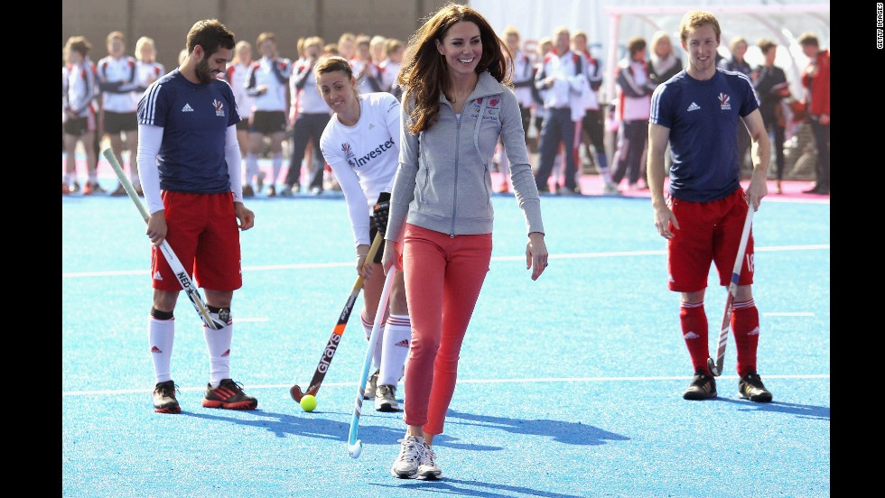 She ditched her usual heels and fascinator to play field hockey with Great Britain's women's team wearing tangerine-colored jeans.