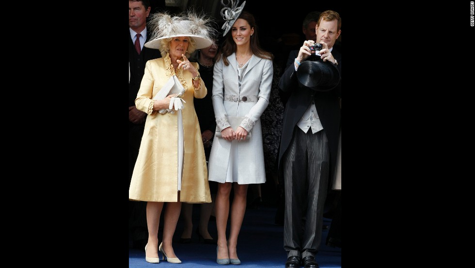 Camilla, duchess of Cornwall, and Kate attend the Order of the Garter Service on June 13 2011. Kate wore a silver coat and fascinator.