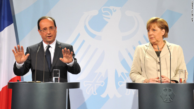 New French President Francois Hollande and German Chancellor Angela Merkel give a joint press conference Tuesday in Berlin.