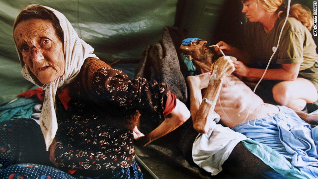 An elderly woman and her husband are treated for injuries inflicted by Serb military forces as they fled Srebrenica in July 1995.