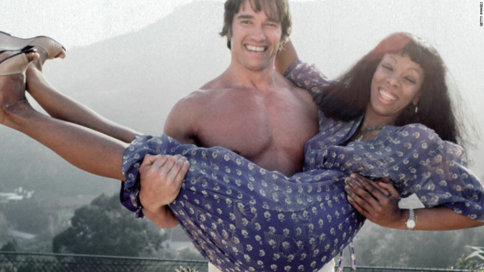 Summer gets a lift from future movie star and politician Arnold Schwarzenegger at her home in Los Angeles in April 1977.