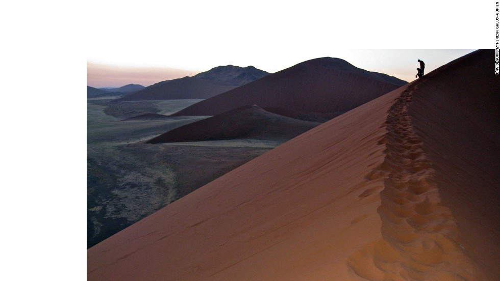 Visitors climb the dunes to catch the sunrise and leave the dramatic Namib-Naukluft National Park before it gets too hot.