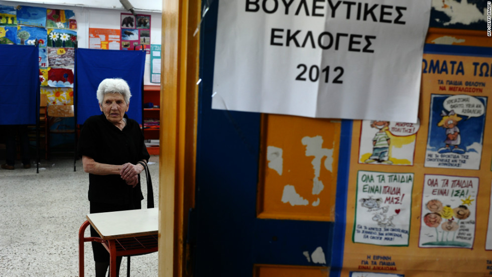 A woman waits to cast her vote during the May 6 elections. No single party won more than 20% support and talks to create a unity government failed. However, parties which oppose the austerity plans gained from popular discontent.
