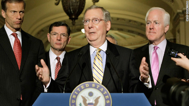 Senate Minority Leader Mitch McConnell, center, and Republican colleagues battled Senate Democrats on budget issues Wednesday.