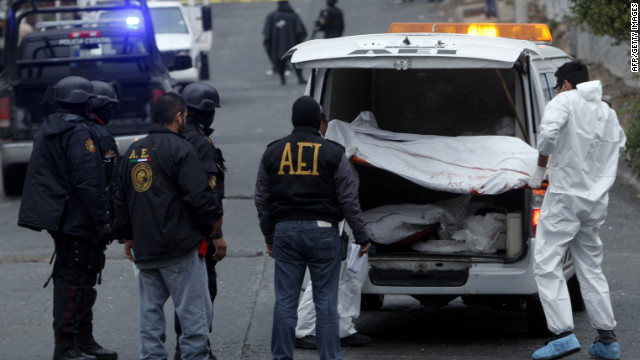 Medical personnel remove one of three bodies killed in drug violence in February in Monterrey, Mexico.