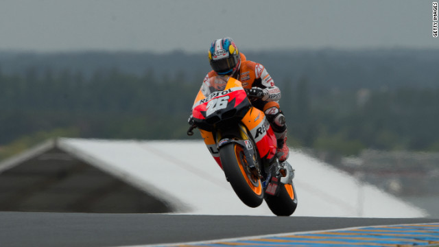 Dani Pedrosa lifts the front wheel of his Repsol Honda during Saturday's MotoGP qualifying action at Le Mans.