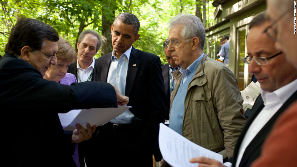 Obama and other members of the G* Summit review documents at Camp David.