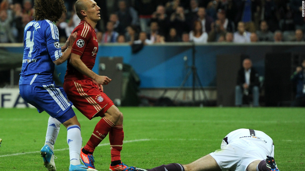 Arjen Robben is left stunned after his penalty effort is saved by Petr Cech and he cannot  convert the follow up.