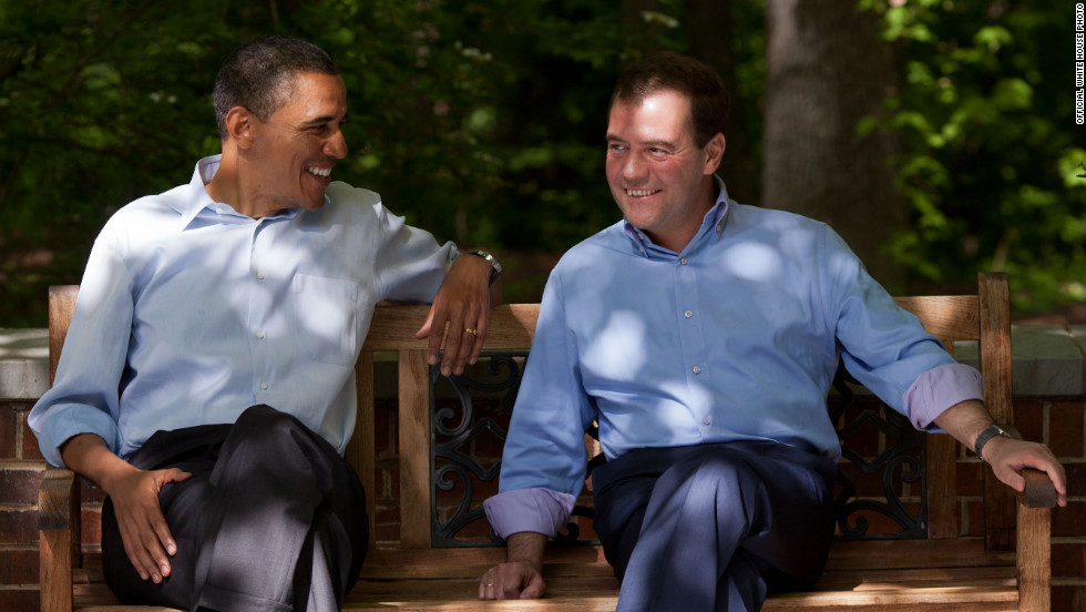 Obama and Medvedev talk on the Laurel Cabin patio.