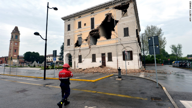A rescue walks in front of the facade of the town hall after a powerful earthquake that shook Italy's industrial and densely populated northeast early on May 20, 2012 in Sant'Agostino village in the Modena province killing at least six people, felling homes and factories and toppling church steeples.  AFP PHOTO / GIUSEPPE CACACE        (Photo credit should read GIUSEPPE CACACE/AFP/GettyImages)