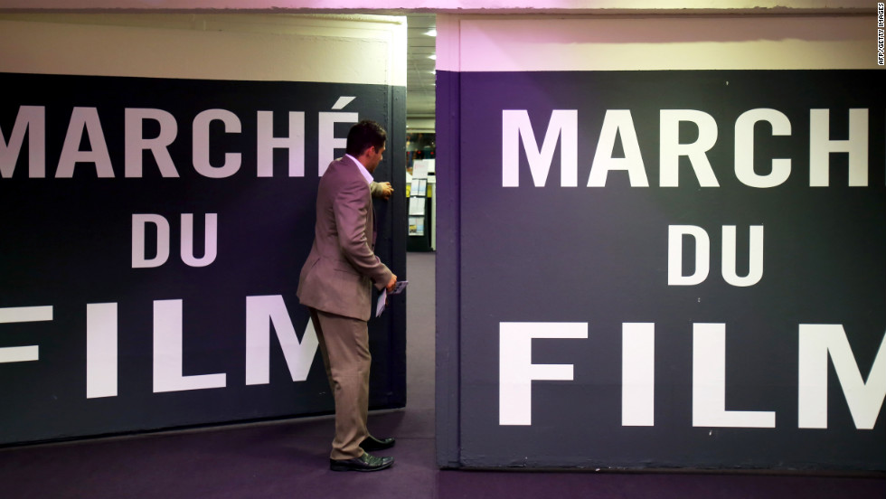 A worker closes a door at the Marche du Film market on the sidelines of the Cannes film festival on Sunday.