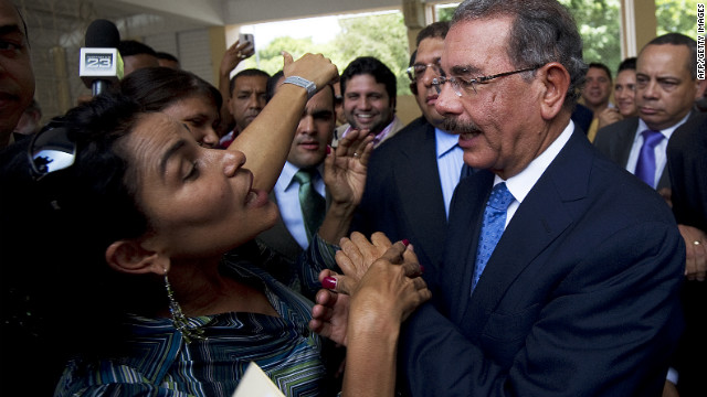Danilo Medina, right, greets a supporter at a polling station in Santo Domingo on Sunday.