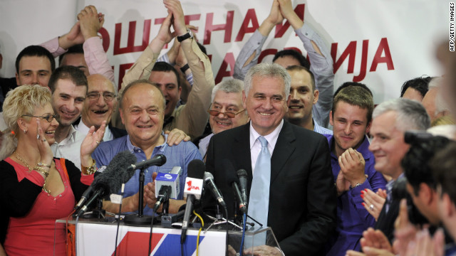 New Serbian President Tomislav Nikolic (C-R) addresses supporters at his party's headquarters in Belgrade on May 20.