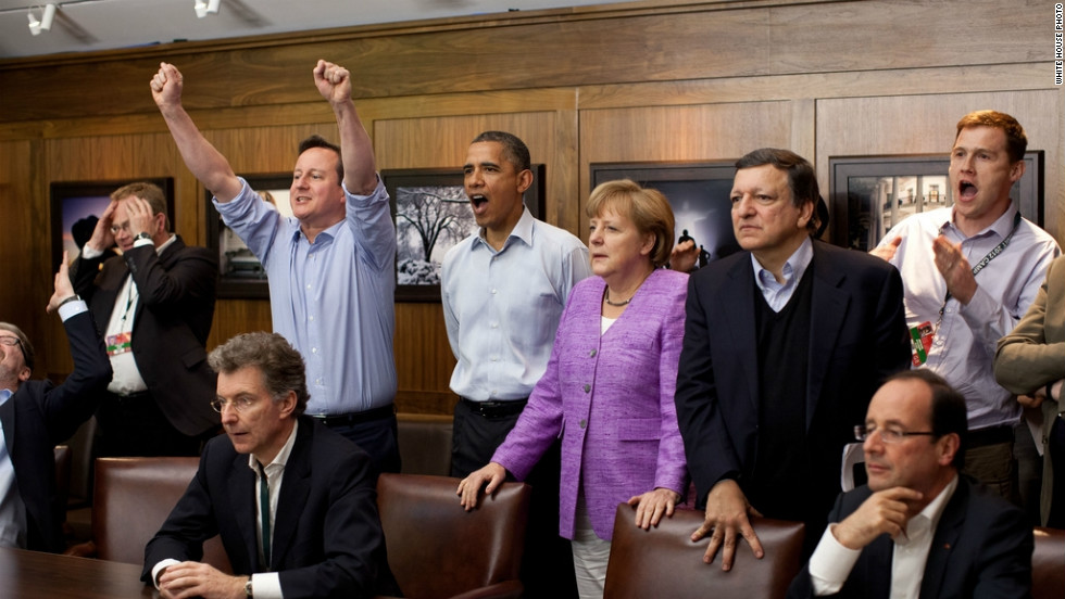 U.S. President Barack Obama watched the action at a G8 summit at Camp David, with British Prime Minister David Cameron to his right and German Chancellor Angela Merkel on his left.
