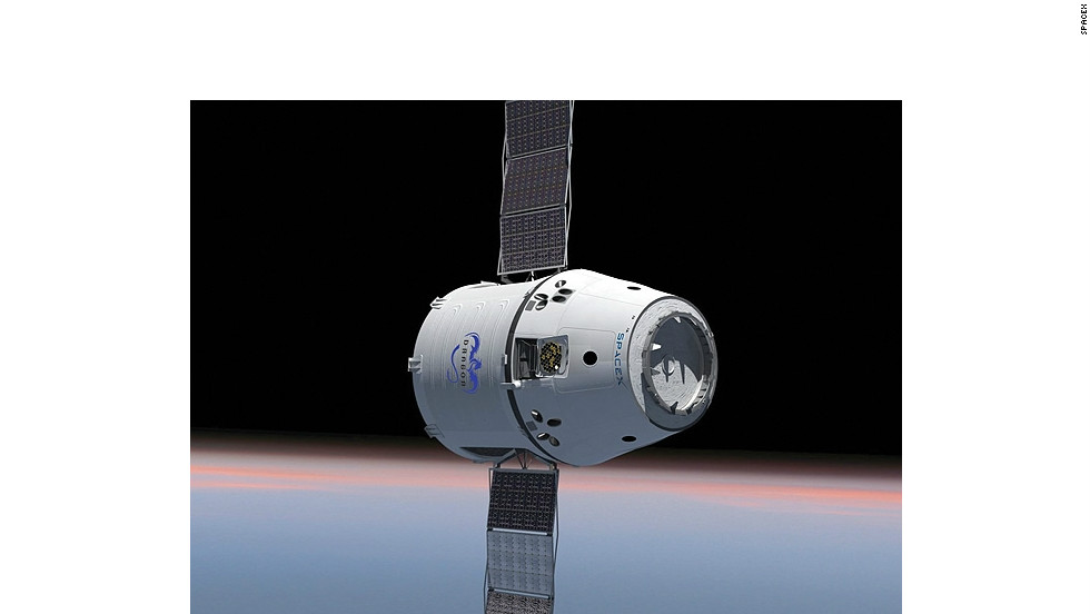 This rendering of the Dragon capsule shows the craft's solar panels fully extended. The capsule launched in May extended its panels in orbit.
