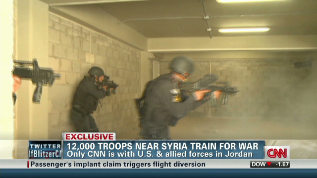 12,000 troops near Syria train for war
