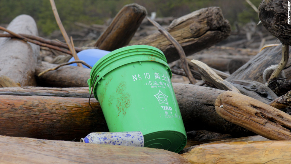 Japanese writing marks the side of a green bucket found on Montague Island.