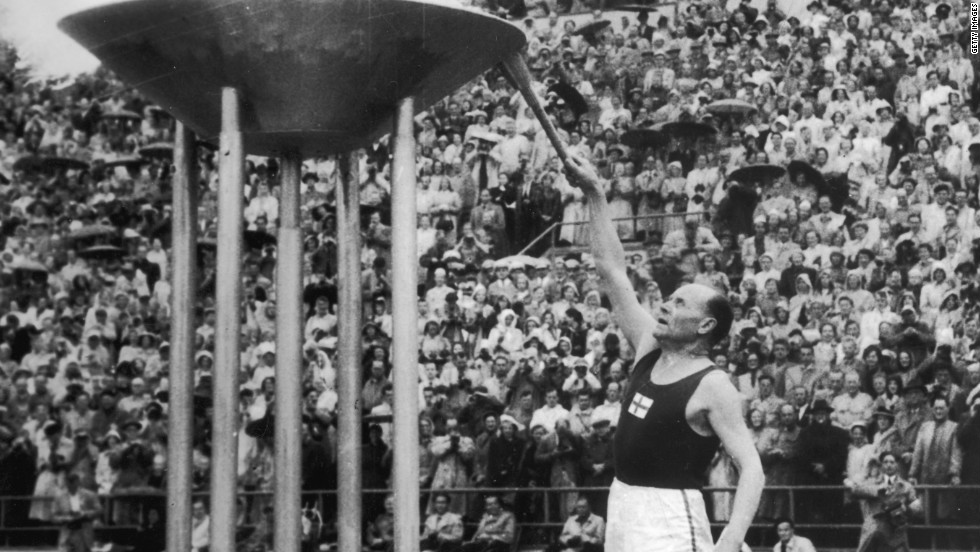 Finnish runner Paavo Nurmi lights the cauldron at the 1952 Helsinki Olympics. It was the first time the flame had been transported by plane. Since then it has been transformed into a radio signal for the 1976 Montreal Olympics and carried underwater by divers during the 2000 Sydney Games.