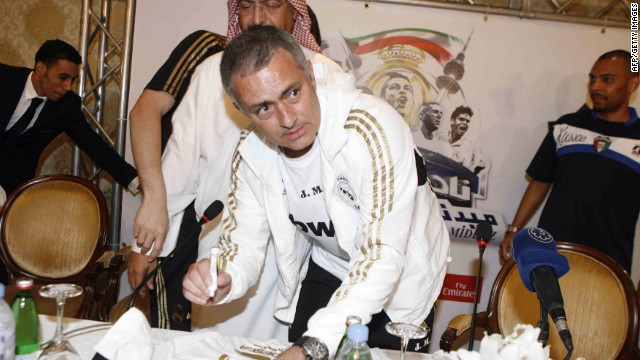 Jose Mourinho signs autographs during Real Madrid's postseason trip to Kuwait on May 15.