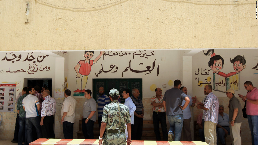 Egyptian men line up to cast their vote Wednesday in Cairo. Some 30,000 volunteers fanned out to ensure voting is fair, said organizers with the April 6 youth movement, which has campaigned for greater democracy in Egypt.