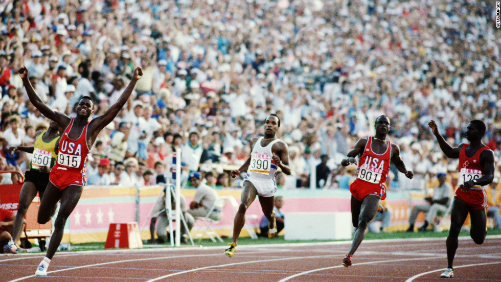 Lewis was the hero of L.A. Marketed as part athlete, part Michael Jackson he was the face of the first games to make a profit and propel the games in to a new commercial era. He won three gold medals, including here in the 4x100 meter final. Behind him in third place is unknown Canadian sprinter Ben Johnson who won bronze. A new rivalry was born.