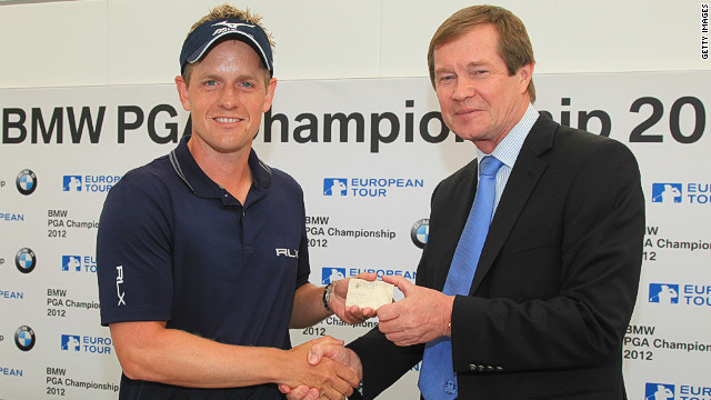 Luke Donald (L) receives his honorary life membership from European Tour chief exec George O'Grady