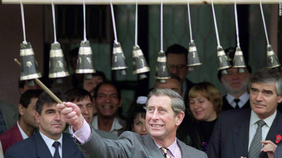 The Prince of Wales plays gypsy bells in the Stolipinovo district of Plovdiv, Bulgaria, on November 9, 1998.