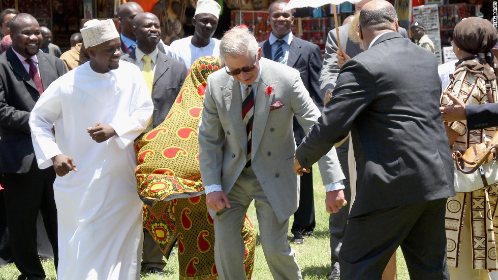 Prince Charles takes part in a chapauringe dance at the Old Fort in Stone Town, Zanzibar, on November 8.
