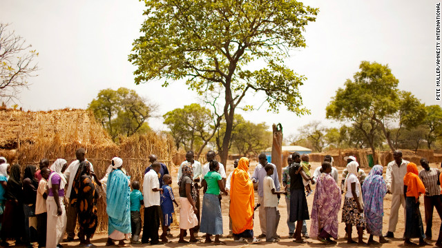"""Nuba refugees """"exchange the peace"""" after a church service in the Yida refugee camp, South Sudan, April 2012."""