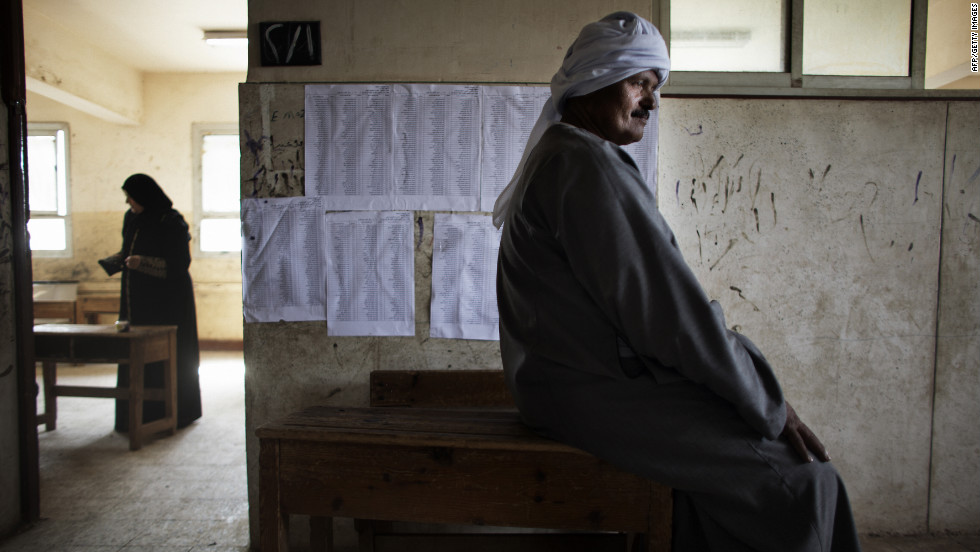 An Egyptian man waits to cast his ballot Thursday north of Cairo. The vote is considered Egypt's first free and fair presidential election in modern history.