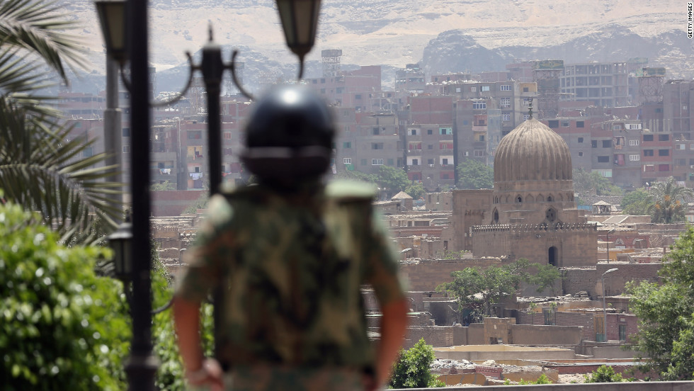 A soldier stands watch in the Egyptian capital on the second day of voting. A pervasive fear exists that the powerful military, which has run the country since Mubarak's fall 16 months ago, could try to hijack the election.